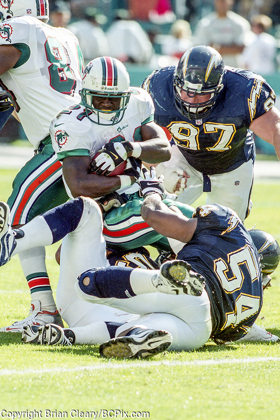 MIAMI, FL - DEC 19, 1999:  Running Back Autry Denson, #21, carries the ball as the Miami Dolphins defeat the San Diego Chargers 12-9 at Joe Robbie Stadium, in Miami, FL. (Photo by Brian Cleary/www.bcpix.com)