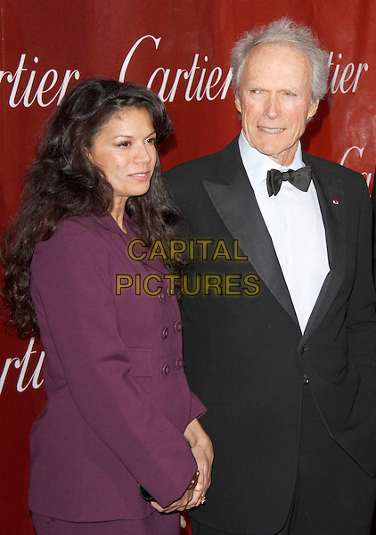 DINA RUIZ & CLINT EASTWOOD.The 21st Annual Palm Springs International Film Festival held at The Civic Center in Palm Springs, California, USA. .January 5th, 2010.half length black white bow tie tux tuxedo jacket purple dress married husband wife.CAP/RKE/DVS.©DVS/RockinExposures/Capital Pictures.