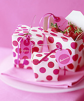 Strawberries and other berries presented in pink and white polka dot boxes