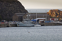Pictured: The Sy Atrevido boat next to the Border Agency boat HMS Protector at Fishguard Port, west Wales, UK. Wednesday 28 August 2019<br />