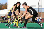 14 November 2015: Michigan's Shannon Scavelli (left) and Wake Forest's Jessy Silfer (right). The Wake Forest University Demon Deacons played the University of Michigan Wolverines at Francis E. Henry Stadium in Chapel Hill, North Carolina in a 2015 NCAA Division I Field Hockey Tournament First Round match. Michigan won the game 2-1.