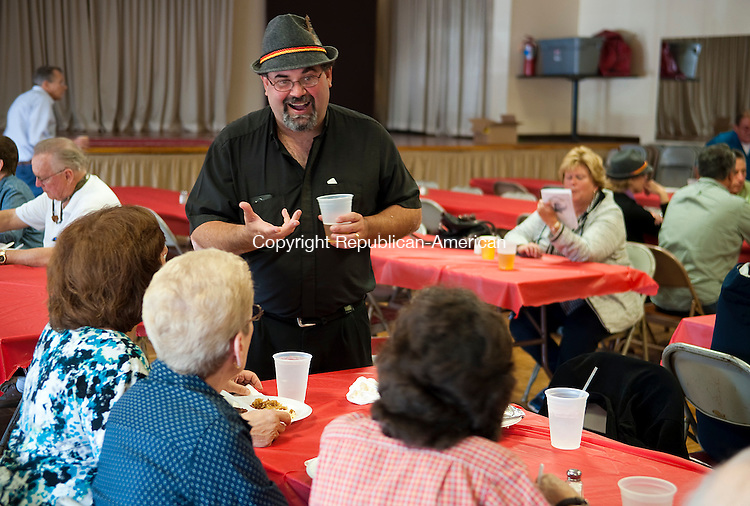 TORRINGTON, CT--- -092615JS05---Father John Granato, head of the Torrington Cluster of Roman Catholic Parishes talks with guests during the second annual Oktoberfest 2015 held Saturday at the Knights of Columbus Hall in Torrington. The event, featured all-day entertainment and food, benefits the Torrington Cluster of Roman Catholic Parishes. <br /> Jim Shannon Republican-American