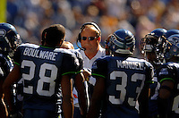 Sep 25, 2005; Seattle, WA, USA; Seattle Seahawks head coach Mike Holmgren listens in on a huddle against the Arizona Cardinals in the second quarter at Qwest Field. Mandatory Credit: Photo By Mark J. Rebilas