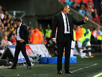 (L-R) Watford manager Marco Silva and Swansea manager Paul Clement who gives the thumbs up to his players during the Premier League match between Swansea City and Watford at The Liberty Stadium, Swansea, Wales, UK. Saturday 23 September 2017