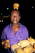 Salvador, Bahia, Brazil. A street vendor selling terracota money box pigs.