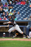 New Britain Rock Cats designated hitter David Dahl (1) lays down a bunt during a game against the Akron RubberDucks on May 21, 2015 at Canal Park in Akron, Ohio.  Akron defeated New Britain 4-2.  (Mike Janes/Four Seam Images)