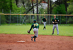 DARMSTADT, GERMANY - May 04: Game 1 between Darmstadt Whippets (black) and Mainz Athletics (green) at match day 2 in the Regionalliga Suedwest at Memory Field sports ground on May 04, 2013 in Darmstadt, Germany. Darmstadt won 13-1. (Photo by Dirk Markgraf).