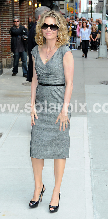 **ALL ROUND PICTURES FROM SOLARPIX.COM**.**SYNDICATION RIGHTS FOR UK, AUSTRALIA, DENMARK, PORTUGAL, S. AFRICA, SPAIN & DUBAI (U.A.E) ONLY**.Michelle Pfeiffer arrives for The Late Show with David Letterman, Sullivan Theater, New York City, NY, USA. 16 June 2009..This pic: Michelle Pfeiffer..JOB REF: 9630 PHZ (Mayer)   DATE: 16_06_2009 .**MUST CREDIT SOLARPIX.COM OR DOUBLE FEE WILL BE CHARGED**.**ONLINE USAGE FEE GBP 50.00 PER PICTURE - NOTIFICATION OF USAGE TO PHOTO @ SOLARPIX.COM**.**CALL SOLARPIX : +34 952 811 768 or LOW RATE FROM UK 0844 617 7637**