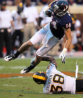 Virginia Cavaliers wide receiver Matt Snyder (14) is up ended by Southern Miss Golden Eagles linebacker Jeremy Snowden (38) during the game at Scott Stadium. Virginia lost to Southern Mississippi 30-24. (Photo/Andrew Shurtleff)