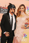 LOS ANGELES, CA- MAY 01: Musician Nikki Sixx (L) and Courtney Bingham attend the 2014 iHeartRadio Music Awards held at The Shrine Auditorium on May 1, 2014 in Los Angeles, California.
