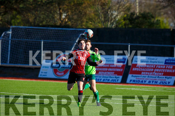 Joseph Diggins of AC Athletic keeps his eye on the ball as he tests the Killarney Celtic defender Conor Randall's in their game in Mounthawk Park on Sunday last