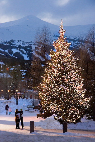 Mother and children view Christmas tree, Breckenridge Ski Area, Colorado,