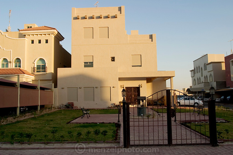 The newly constructed three-story Al Haggan home in Kuwait City, Kuwait. (Supporting image from the project Hungry Planet: What the World Eats.)