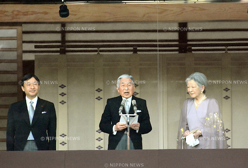 December 23, 2013, Tokyo, Japan - Japan's Emperor Akihito reads a statement as he receives well-wishers celebrating his 80th birthday during a genreral audiencre at the Imperial Palace in Tokyo on Monday, December 23, 2013. Akihito told the crowd of some 25,000 people that he prayed the coming year will be a good year for all. Flanking the monarch are: Crown Prince Naruhito and Empress Michiko. (Photo by Natsuki Sakai/AFLO)