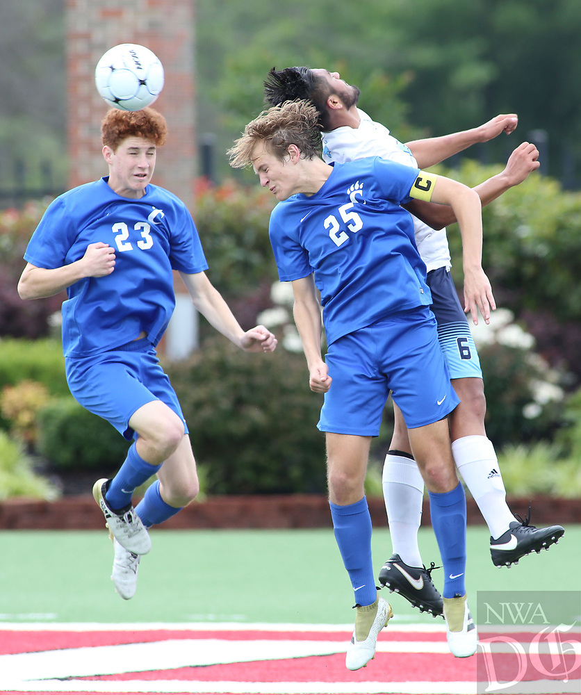 NWA Democrat-Gazette/DAVID GOTTSCHALK  Springdale Har-Ber Wildcats' Jimmy Araujo fights with Conway Wampus Cats' Brady Rosenow (25) and Evan Trimble during first half play at the 7A 2017 State Soccer Tournament at Mayo-Thompson Stadium at Fort Smith Northside High School. Springdale Har-Ber won 2-0.