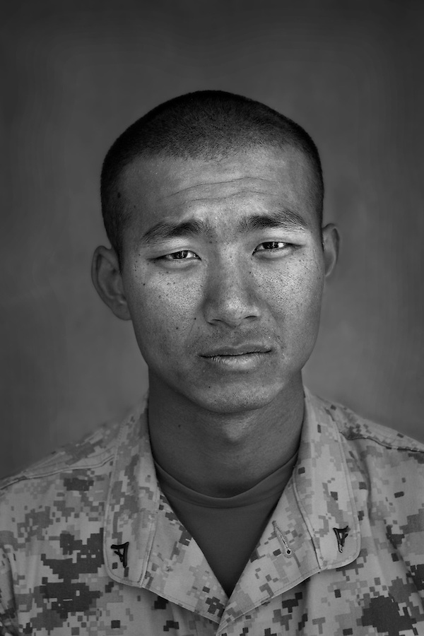 Lcpl. Jackie Tran, 20, Los Angeles, California, 3rd Platoon, Kilo Co., 3rd Battalion 1st Marines, 1st Marine Division, United States Marine Corps, at the company's firm base in Haditha, Iraq on Sunday Oct. 22, 2005.