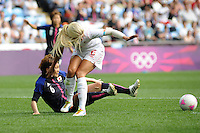 25.07.2012 Coventry, England. Mizuho SAKAGUCHI (Japan) and Kaylyn KYLE (Canada)  in action during the Olympic Football Women's Preliminary game between Japan and Canada from the City of Coventry Stadium