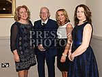 Eamon Faulkner with his daughters Sandra, Veronica and Eileen at the St. Colmcilles gala ball in City North hotel. Photo:Colin Bell/pressphotos.ie