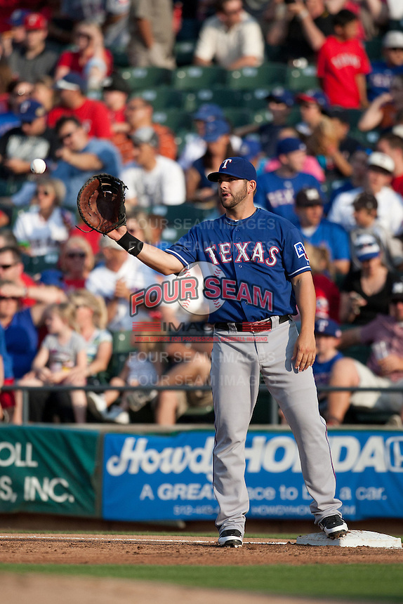 "Texas Rangers first baseman Mitch Moreland #18 on defense during the MLB exhibition baseball game against the ""on defense"" Round Rock Express on April 2, 2012 at the Dell Diamond in Round Rock, Texas. The Rangers out-slugged the Express 10-8. (Andrew Woolley / Four Seam Images)."