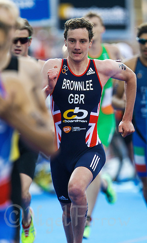 12 JUL 2014 - HAMBURG, GER - Alistair Brownlee (GBR) from Great Britain races from transition at the start of the run at the elite men's 2014 ITU World Triathlon Series round in the Altstadt Quarter, Hamburg, Germany (PHOTO COPYRIGHT © 2014 NIGEL FARROW, ALL RIGHTS RESERVED)