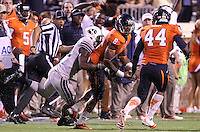 Virginia safety Anthony Harris (8) laterals the ball to Virginia linebacker Henry Coley (44) after intercepting the ball from Brigham Young running back Jamaal Williams (21) during the second half of the game in Charlottesville, Va. Virginia defeated Brigham Young 19-16. Photo/Andrew Shurtleff