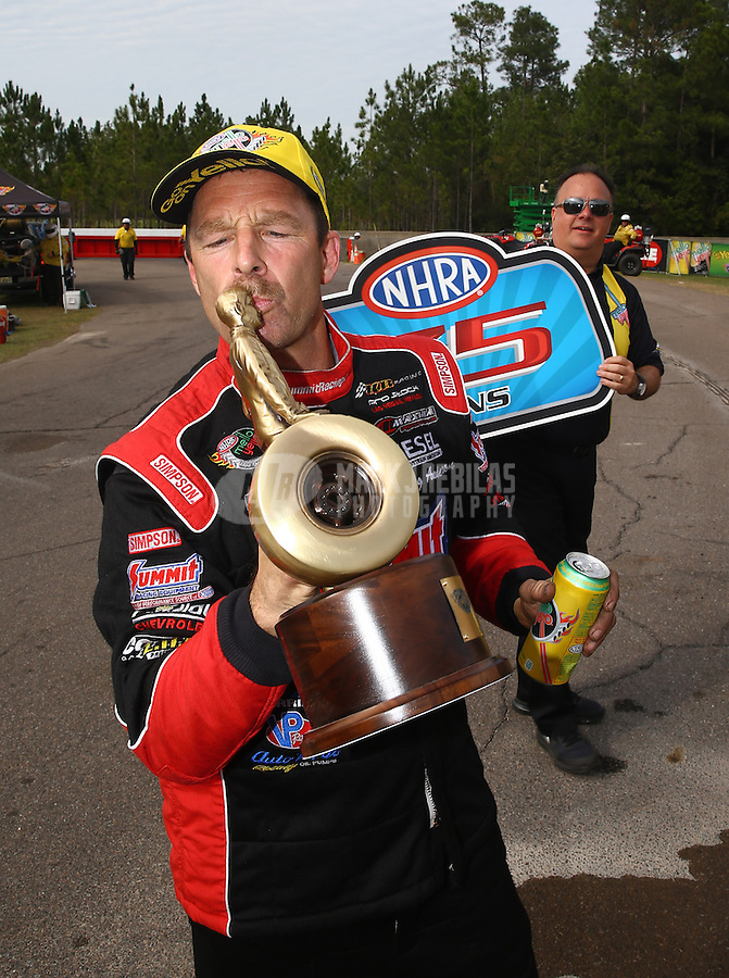 Mar 15, 2015; Gainesville, FL, USA; NHRA pro stock driver Greg Anderson celebrates after winning the Gatornationals at Auto Plus Raceway at Gainesville. Mandatory Credit: Mark J. Rebilas-