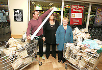 09/06/14<br /> Supermarket dash prize winners Herbie,Lorraine and Anna Birch pictured at Dunnes Stores ,Donaghmede where they took part in the challenge to fill their trollies&hellip;.<br /> Collins Photos