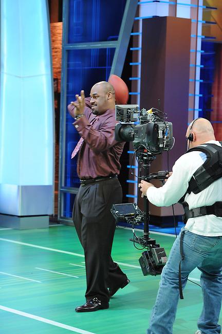 January  08, 2012 - Bristol, CT - Studio E:  Sunday NFL Countdown, guest, Donovan McNabb tosses the ball with Cris Carter for a bump between segments. .Credit: Joe Faraoni/ESPN