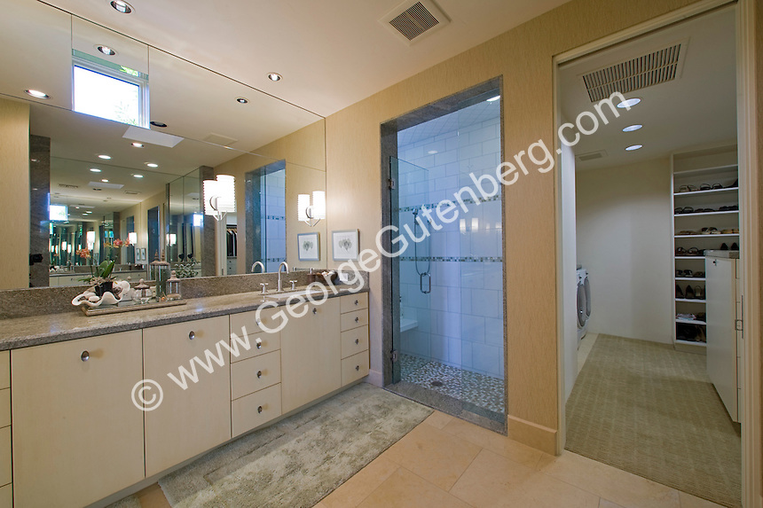 Modern bathroom shown with walk-in closet in background Stock photo of master bath, en suite, bathroom