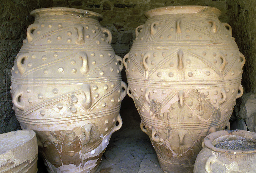 Pithoi, large storage vases or urns, in one of the many store-house rooms in the palace at Knossos.