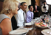 United States President Barack Obama (2nd L) chats with campaign volunteers during a lunch August 10, 2011 at Ted's Bulletin in Washington, DC. Obama had lunch with campaign volunteers who were selected based on essays they wrote about organizing..Credit: Alex Wong / Pool via CNP