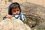 A Bedouin Palestinian boy plays outside his makeshift tent in the Ein al-Uja village, close to the West Bank city of Jericho, April 27, 2019. Israeli bulldozers had demolished the village in several times, but villagers said that they insist on remaining in their village. Photo by Ayat Arqawy
