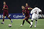 08 July 2007: Portugal's Bruno Gama (7) dribbles past Gambia's Alagie Ngum (4). Gambia's Under-20 Men's National Team defeated Portugal's Under-20 Men's National Team 2-1 in a Group C opening round match at Olympic Stadium in Montreal, Quebec, Canada during the FIFA U-20 World Cup Canada 2007 tournament.