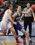 SIOUX FALLS MARCH 22:  Haley Fowler #24 of Lubbock Christian dribbles past Florida Southern defender Jensen Blassage #15 during their quarterfinal game at the NCAA Women's Division II Elite 8 Tournament at the Sanford Pentagon in Sioux Falls, S.D. (Photo by Dick Carlson/Inertia)
