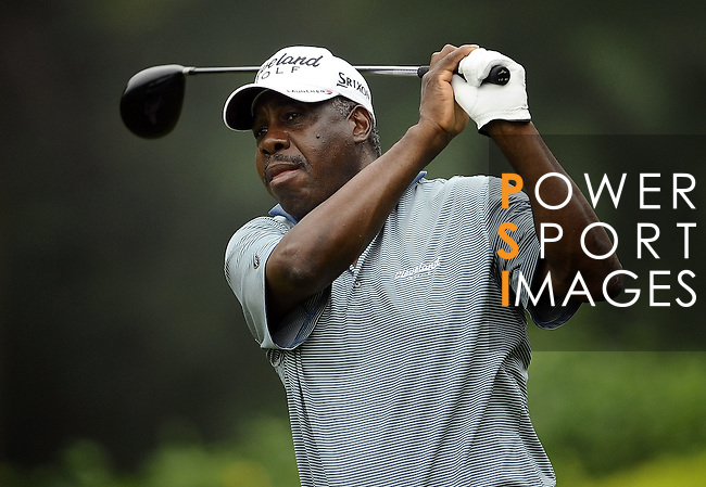 TAIPEI, TAIWAN - NOVEMBER 18:  Delroy Cambridge of Jamaica tees off on the 16th hole during day one of the Fubon Senior Open at Miramar Golf & Country Club on November 18, 2011 in Taipei, Taiwan. Photo by Victor Fraile / The Power of Sport Images