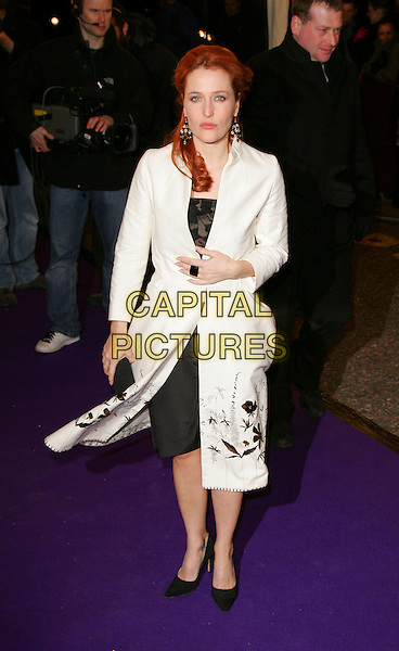 GILLIAN ANDERSON.British Comedy Awards 2007, London Studios, South Bank, London, England..December 5th 2007.full length white coat black print ring clutch bag purse windy.CAP/ROS.©Steve Ross/Capital Pictures