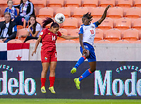 HOUSTON, TX - FEBRUARY 3: Maryorie Perez #14 of Panama goes up for a header with Nerilia Mondesir #10 of Haiti during a game between Panama and Haiti at BBVA Stadium on February 3, 2020 in Houston, Texas.
