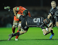 14th December 2013; Craig Clarke, Connacht, is tackled by Theirry Dusautoir, Toulouse. Heineken Cup Pool 3, round 4, Connacht v Toulouse, The Sportsground, Galway. Picture credit: Tommy Grealy/actionshots.ie.