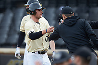 Bruce Steel (17) of the Wake Forest Demon Deacons is congratulated by his teammates after scoring a run during the game against the Notre Dame Fighting Irish at David F. Couch Ballpark on March 10, 2019 in  Winston-Salem, North Carolina. The Demon Deacons defeated the Fighting Irish 7-4 in game one of a double-header.  (Brian Westerholt/Four Seam Images)