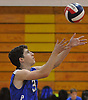 Justin Suzzan #3 of Port Washington serves during a Nassau County varsity boys volleyball match against Bellmore JFK at Port Washington High School on Monday, Oct. 17, 2016. Port Washington won in straight sets; 25-23, 25-21, 25-15.