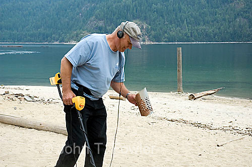 Jew Detector: Man Searching For Coins With Metal Detector