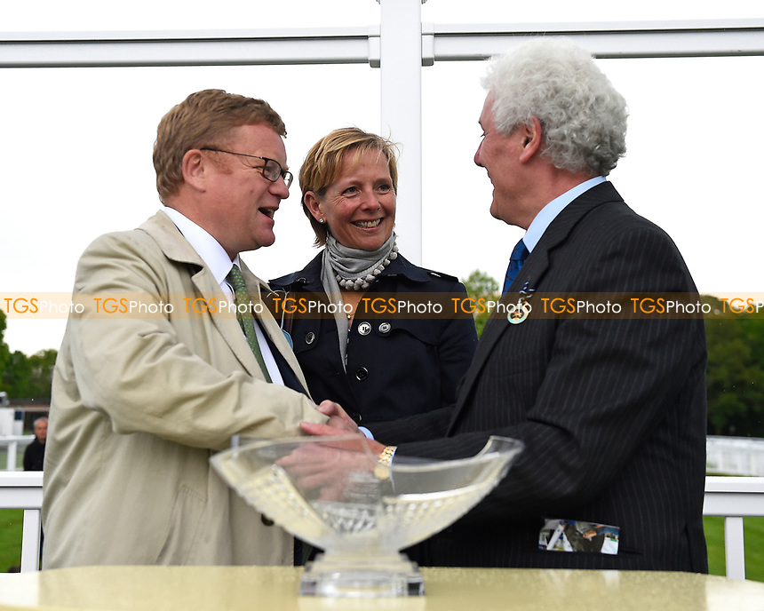 Connections of White Chocolate are presented with their trophy during Afternoon Racing at Salisbury Racecourse on 18th May 2017