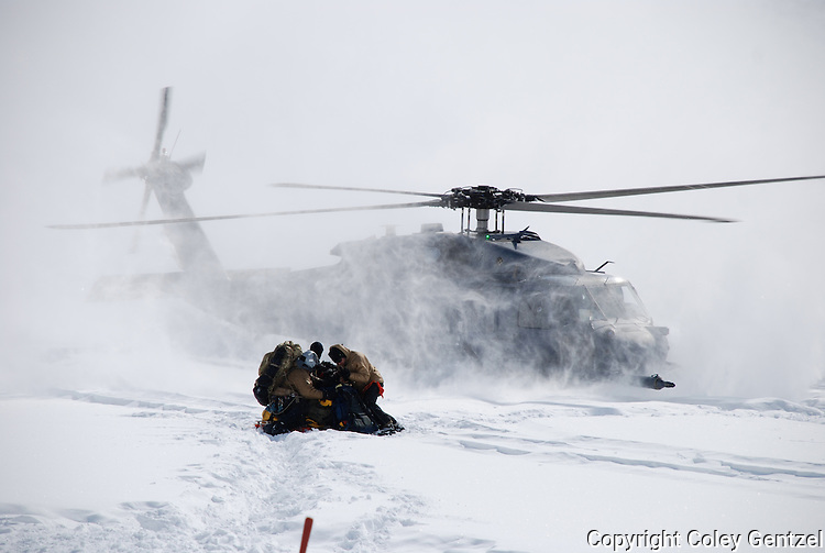 Pavehawk helicopter and rescuers at Denali base camp