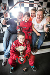 © Joel Goodman - 07973 332324 . 4 August 2013 . Daytona Manchester, Unit 4 Circle South, Wharfside Way, Trafford Park, Manchester M17 1NF , UK . L-R dad Joe Burrows (42) , son Gabe Burrows (front) (12) , son Michael Burrows (nine) , son Alex Burrows (15) and mum Sally Burrows (42) from Stretford (correct - NB Gabe just recently turned nine - it says eight on the brief) . Gabe and Michael have won numerous go-karting trophies . Photo credit : Joel Goodman