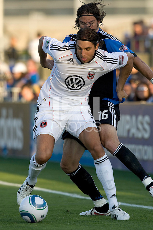 Dejan Jakovic of DC United controls the ball away from Alan Gordon of Earthquakes during the game at Buck Shaw Stadium in Santa Clara, California on July 30th, 2011.   DC United defeated San Jose Earthquakes, 2-0.