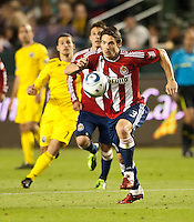 CARSON, CA – APRIL 9, 2011: Chivas USA defender Heath Pearce (3) races to the ball during the match between Chivas USA and Columbus Crew at the Home Depot Center, April 9, 2011 in Carson, California. Final score Chivas USA 0, Columbus Crew 0.