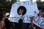 Clashes between secular and ultra-orthodox Jews, surrounding the issue of the opening of the Karta parking lot in Jerusalem, Saturday, July 18, 2009. In the photo: Haredi (ultra-orthodox) protestors attempt to tear signs held by secular demonstrators saying that says that keeping the Sabbath should come from the heart and not be forced. Photo By: Tess Scheflan / JINI