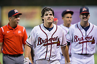 Bradley Keller (13) of the Danville Braves walks off the field following his game winning hit in the bottom of the 11th inning against the Princeton Rays at American Legion Post 325 Field on June 25, 2017 in Danville, Virginia.  The Braves walked-off the Rays 7-6 in 11 innings.  (Brian Westerholt/Four Seam Images)