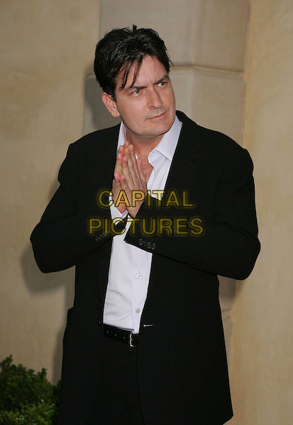 CHARLIE SHEEN .Chrysalis's 5th Annual Butterfly Ball held at the Italian Villa of Carla and Fred Sands, Bel Air, California, USA..June 10th, 2006.Photo: Russ Elliot/AdMedia/Capital Pictures.Ref: RE/ADM.half length black suit jacket hands together praying.www.capitalpictures.com.sales@capitalpictures.com.© Capital Pictures.