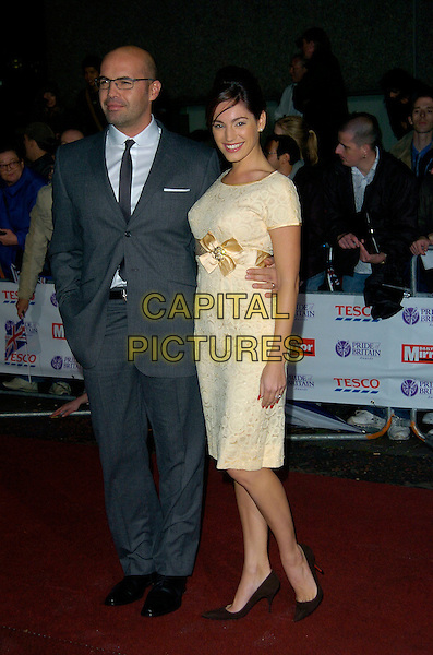 BILLY ZANE & KELLY BROOK.Pride of Britain Awards, The London Studios.9th October 2007 London, England.full length glasses grey gray suit hand in pocket cream gold vintage dress sash bow black Christian Louboutin shoes couple .CAP/CAN.©Can Nguyen/Capital Pictures